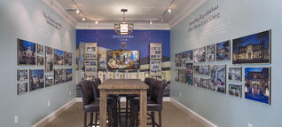 The London Bay Homes sales room features images of beautiful luxury custom homes
