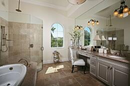 Reflect your personal style by including a custom vanity.